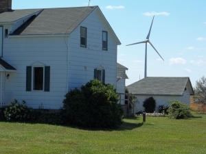 Not the photo the Standard-Freeholder used, of a turbine alone in a field. THIS is reality: a house and turbine near KIncardine, Ont.